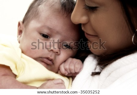 Hispanic mother holding child