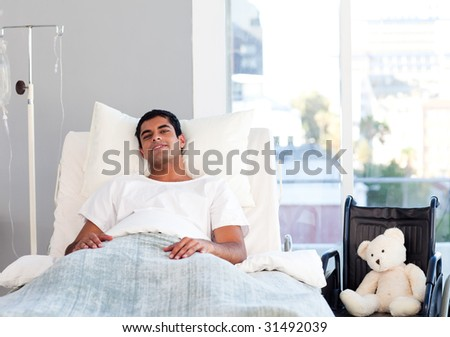 Hispanic patient resting in bed in hospital