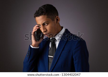 Hispanic Teenager Dressed Well Dressed in Suit, and Using Cellphone, Smartphone #1304402047