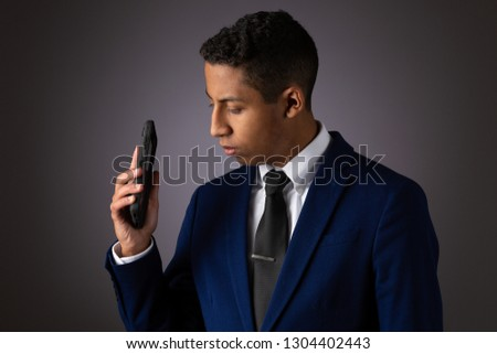 Hispanic Teenager Dressed Well Dressed in Suit, and Using Cellphone, Smartphone #1304402443