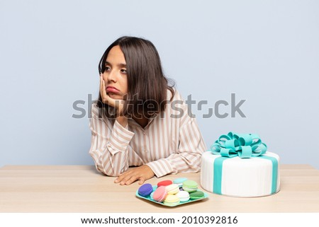 hispanic woman feeling bored, frustrated and sleepy after a tiresome, dull and tedious task, holding face with hand Сток-фото ©