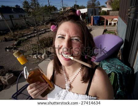 Hispanic woman in front of house with messy yard