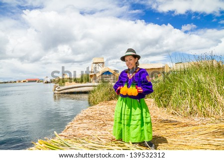Hispanic woman in traditional indigenous clothing, Puno, Uros islands, Peru #139532312