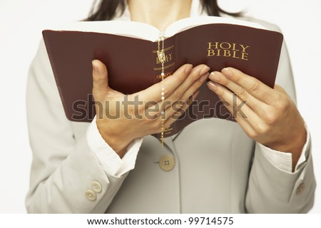 Hispanic woman reading Bible