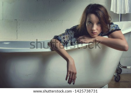 Hispanic Woman Relaxing In Bathtub In Bathroom. Woman Relaxing In Bathtub At Luxury Spa. Bath Time. #1425738731