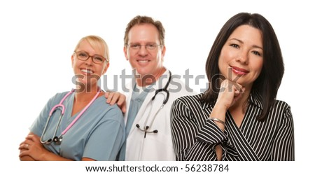 Hispanic Woman with Male Doctor and Nurse Isolated on a White Background.