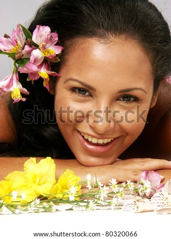 Hispanic young woman portrait with flowers. - stock photo