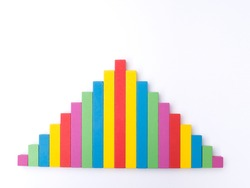 histogram with Gaussian (normal or bell shaped) distribution - rough representation with colorful wooden sticks on white background