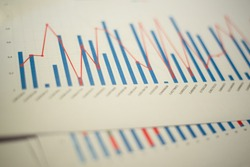 Histograms, charts and diagrams printed on white sheets of paper for data analysis