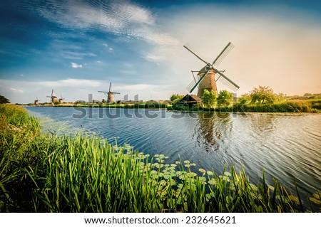 Stock Photo Historians Dutch windmills near Rotterdam.