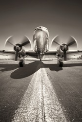 historic aircraft is waiting for take off on a runway