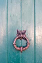 Historic antique copper door knocker