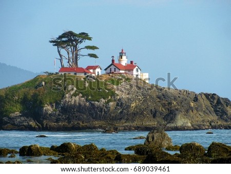 Historic Battery Point Lighthouse keeps watch from an island off the coast of Crescent City, California, helping navigators travel the ocean safely.