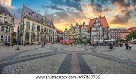 Historic Bremen market square in the centre of the Hanseatic City of Bremen with view on former guild house The Schuetting and famous Raths buildings in beautiful evening light at sunset, Germany