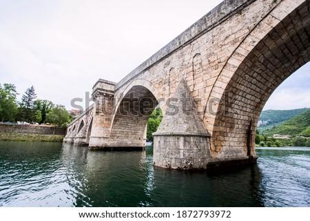 Historic bridge over the Drina River, Famous Tourist Attraction, The Mehmed Pasa Sokolovic Bridge in Visegrad, Bosnia and Herzegovina. Stock photo ©