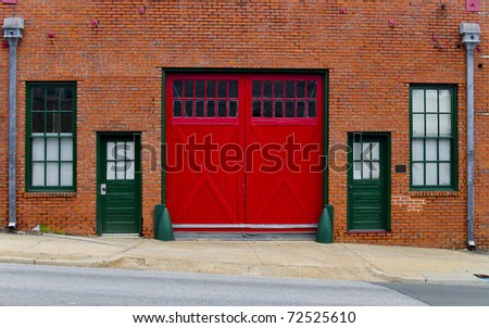 Historic building facade with the red garage gate