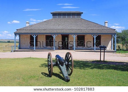 historic building with cannon...