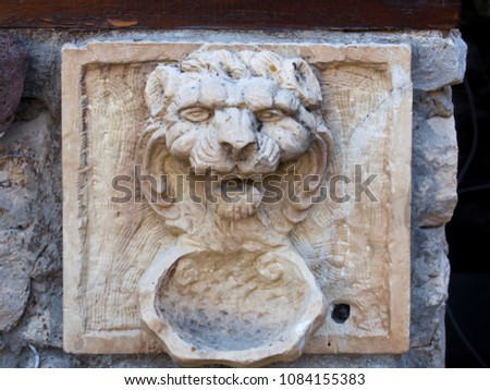 historic carved stone lion's...