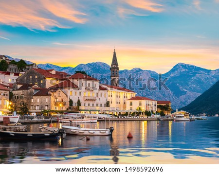 Historic city of Perast in the Bay of Kotor in summer at sunset