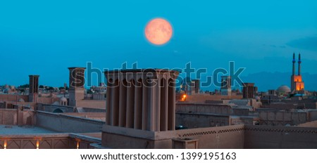 """Historic City of Yazd with famous wind towers in the background full moon at twilight blue hour- YAZD, IRAN """"Elements of this image furnished by NASA"""""""