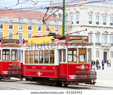 historic classic red tram of Lisbon built partially of wood in front of Lisbons central square Praca de Comercio, Portugal