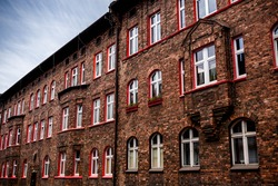 Historic coal miners settlement - Nikiszowiec, district of Katowice in Silesia, Poland. Traditional workers' housing estate (familoks) made of brick
