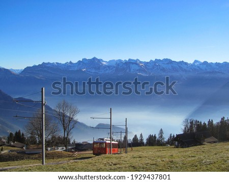 Historic cog railway to Mount Rigi, Switzerland, in front of alpine panorama Stock fotó ©