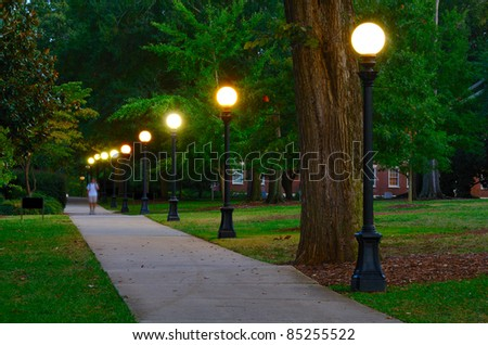 Historic college campus at dusk with lamp posts