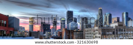 Historic Core and Financial District of Downtown Los Angeles during sunset.  The image shows smog and pollution.  All building logos has been edited out. #321630698