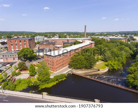 Historic Francis Cabot Lowell Mill building at Charles River and Waltham historic city center aerial view in city of Waltham, Massachusetts MA, USA.  Stock fotó ©