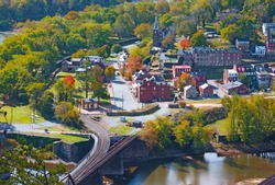 Historic Harpers Ferry town photographed a high point overlook, West Virginia, USA. Early autumn in the town where Potomac and Shenandoah rivers meet each other.