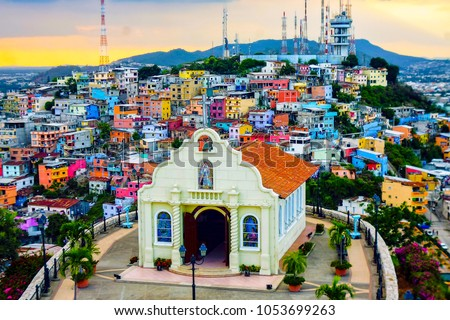 Historic Hilltop Church with Painted Hill Side Buildings at Sunset (Guayaquil, Ecuador).
