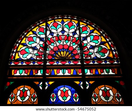 Historic house glass stained window - stock photo