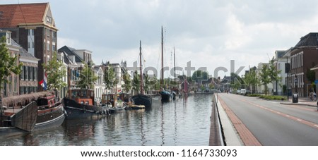 Historic houses and historic ships along the canal in the city of Assen, Drenthe, Netherlands #1164733093