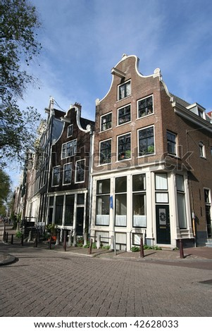 Historic houses in old Amsterdam on the corner of Brouwersgracht