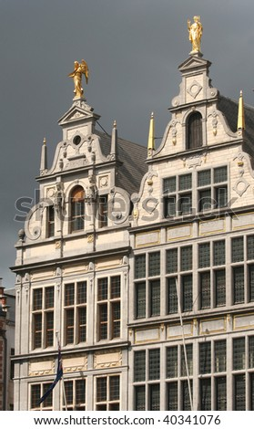 Historic houses on Antwerp Market Place with raincloud background