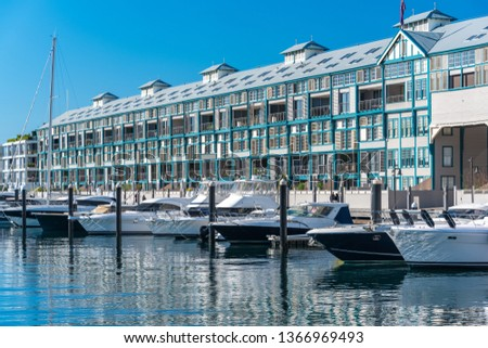 Historic landmark Woolloomooloo wharf with yachts and boats on sunny day #1366969493