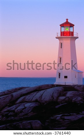 historic lighthouse at peggy's cove nova scotia canada