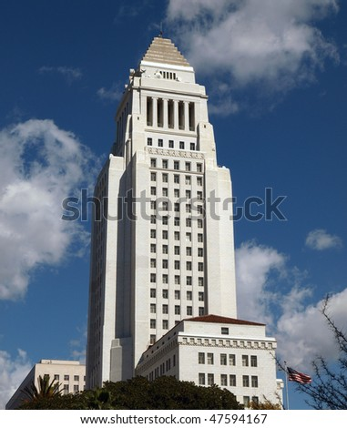 Historic Los Angeles City Hall with a partly cloudy sky.
