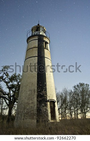Historic Madisonville Lighthouse on the shore of Lake Ponchartrain at the mouth of the Tchefuncte river in St. Tammany Parish Louisiana.
