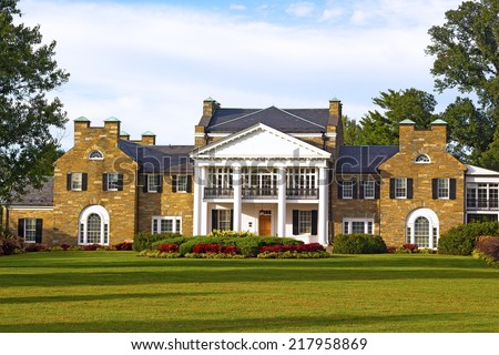 Historic Mansion at Civic Center Park in Rockville, Maryland. Glenview mansion with formal gardens at sunset.