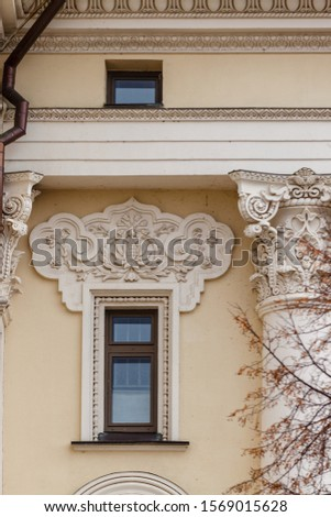 Historic mansions with beautiful architecture columns and bas-reliefs #1569015628