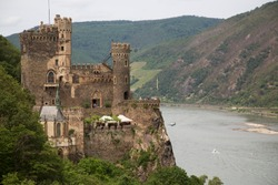 Historic medieval castle on top of the hill with panoramic view over the river landscape and valley