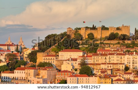 historic mediterranean architecture with with castle  Sao Jorge at sunset in Lisboa, Portugal