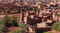 Historic Moorish ksar Ait Benhaddou, UNESCO World Heritage Site, with historic loam buildings located on a river near Ouarzazate, Morocco, Africa.