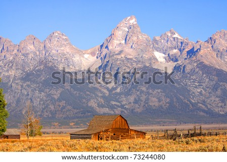 Historic moulton barn in front of Grand Tetons mountain range