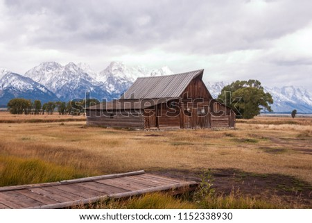 Historic Moulton Barn on Mormon Row with snow-covered mountains in Moose, Wyoming