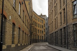 Historic, narrow street in Southwark, London.  Valentine Place has existed since the 18th century and was overtaken by the current warehouse and factory buildings in late Victorian times.