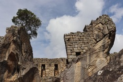 Historic old peruvian secret Inca ruin, ancient UNESCO tourism landmark Machu Picchu with traditional stone wall houses and scenic mountain landscape in sacred valley near Cusco, Peru, South America.