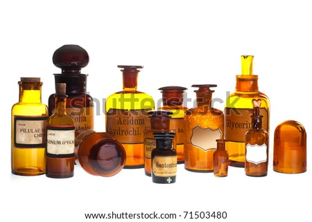 historic old pharmacy bottles with label on white background